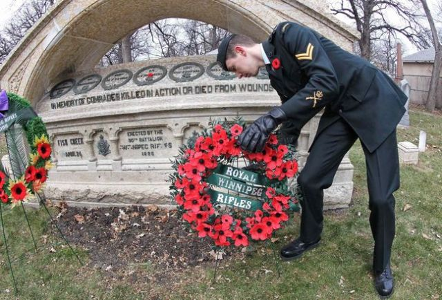 Remembrance Sunday, Cpl. Kyle Hall lays a wreath at the RWR Memorial, St. John's Cathedral Churchyard